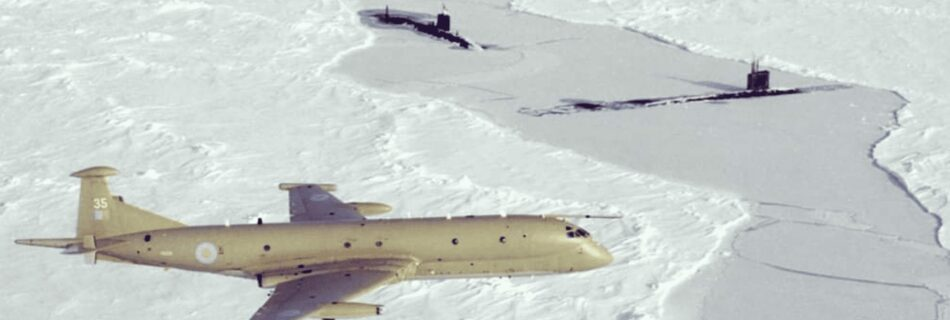 Shows a Nimrod Sopy Plane overflying two submaries surfaced in ICE